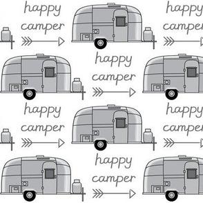 vintage silver trailer with happy camperarrow