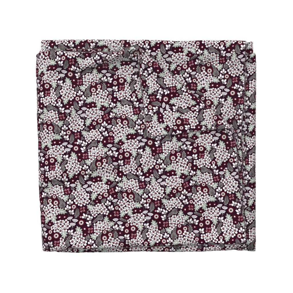 Wyandotte Duvet Cover featuring Winter Holiday Floral by dearchickie
