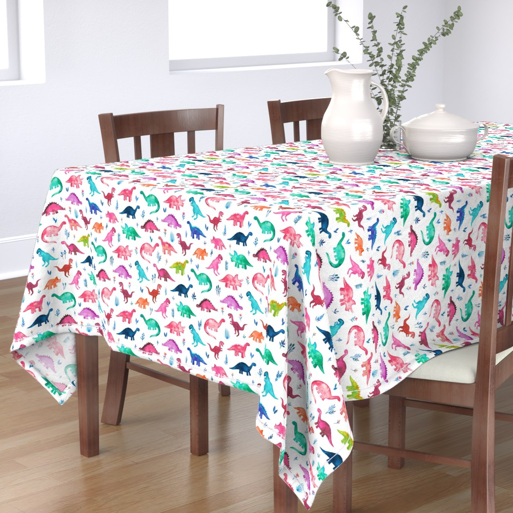 Bantam Rectangular Tablecloth featuring Little Multicolored Dinos on White by micklyn