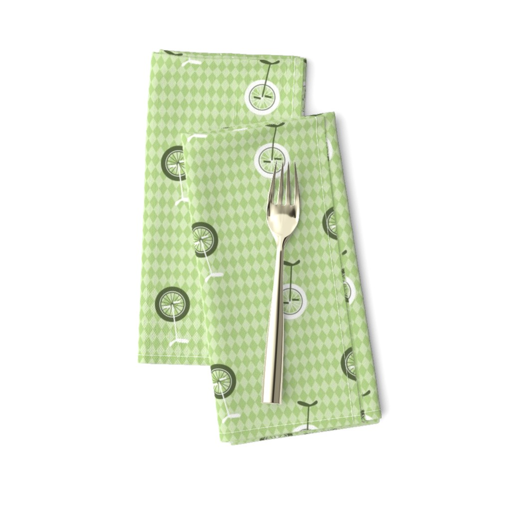 Amarela Dinner Napkins featuring unicycles light green by michaelakobyakov