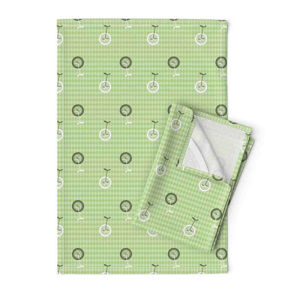 Orpington Tea Towels featuring unicycles light green by michaelakobyakov