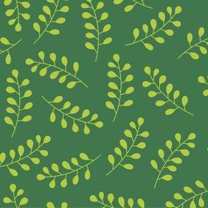 Green laurel branches on dark green