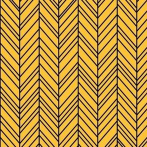 herringbone feathers golden honey on black
