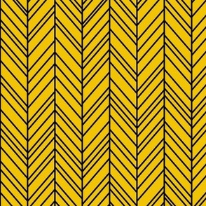 herringbone feathers mustard yellow on black
