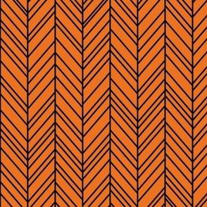 herringbone feathers orange on black