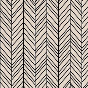 herringbone feathers sand on black