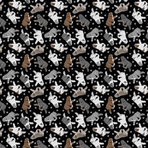 Trotting Polish Lowland Sheepdogs and paw prints - tiny black
