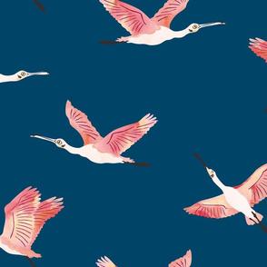 Flying Spoonbills on navy