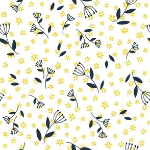 Tiny yellow flowers and black twigs