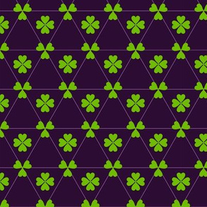 Green clover on purple background.