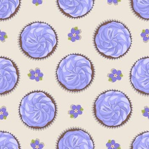 cakes with purple cream and flower
