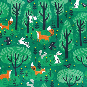 Foxes in the emerald forest in green