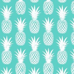 pineapples on teal