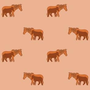 orange mama and baby horse on peach