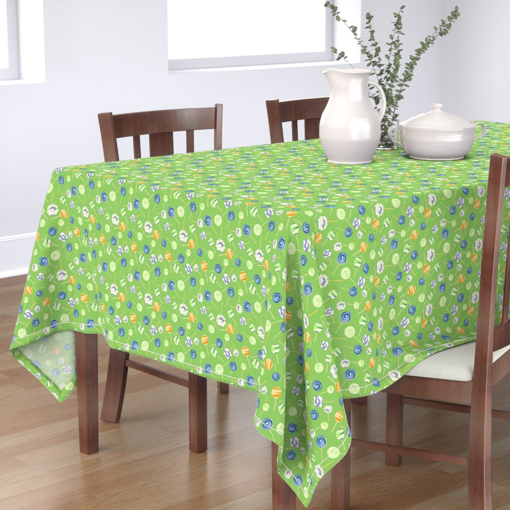 Bantam Rectangular Tablecloth featuring Lollipops on green background by jaanahalme