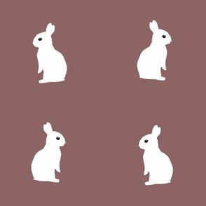 sitting rabbits  - rosy brown