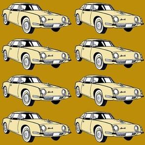 1963 Studebaker Avanti in cream on tan background