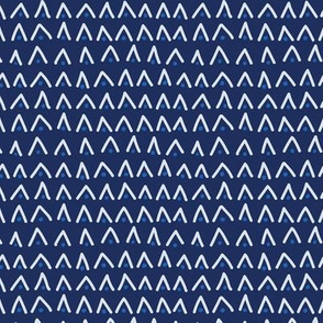 Triangle and dot stripe design on a navy base