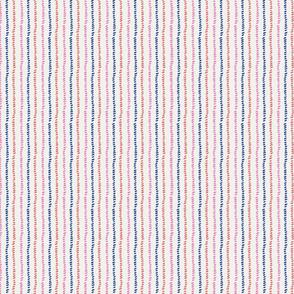 Vertical, dotted textured stripe on cream