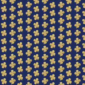 gold four leaf clover on navy Luck of the irish notre dame fighting irish