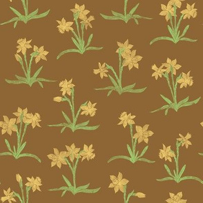 tiny yellow daffodils on earthy brown