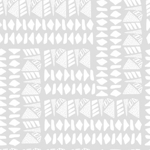 White textured geometric shapes on light grey