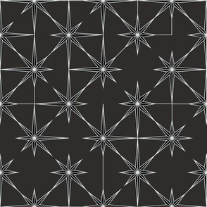 starburst in black and white on charcoal