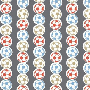 Soccer balls in red, blue & gold