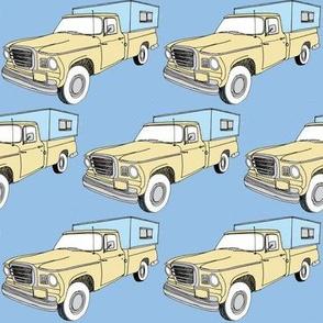 Studebaker Champ Camper Truck on blue