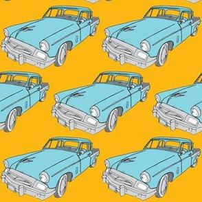 1955 Studebaker (blue car on orange)