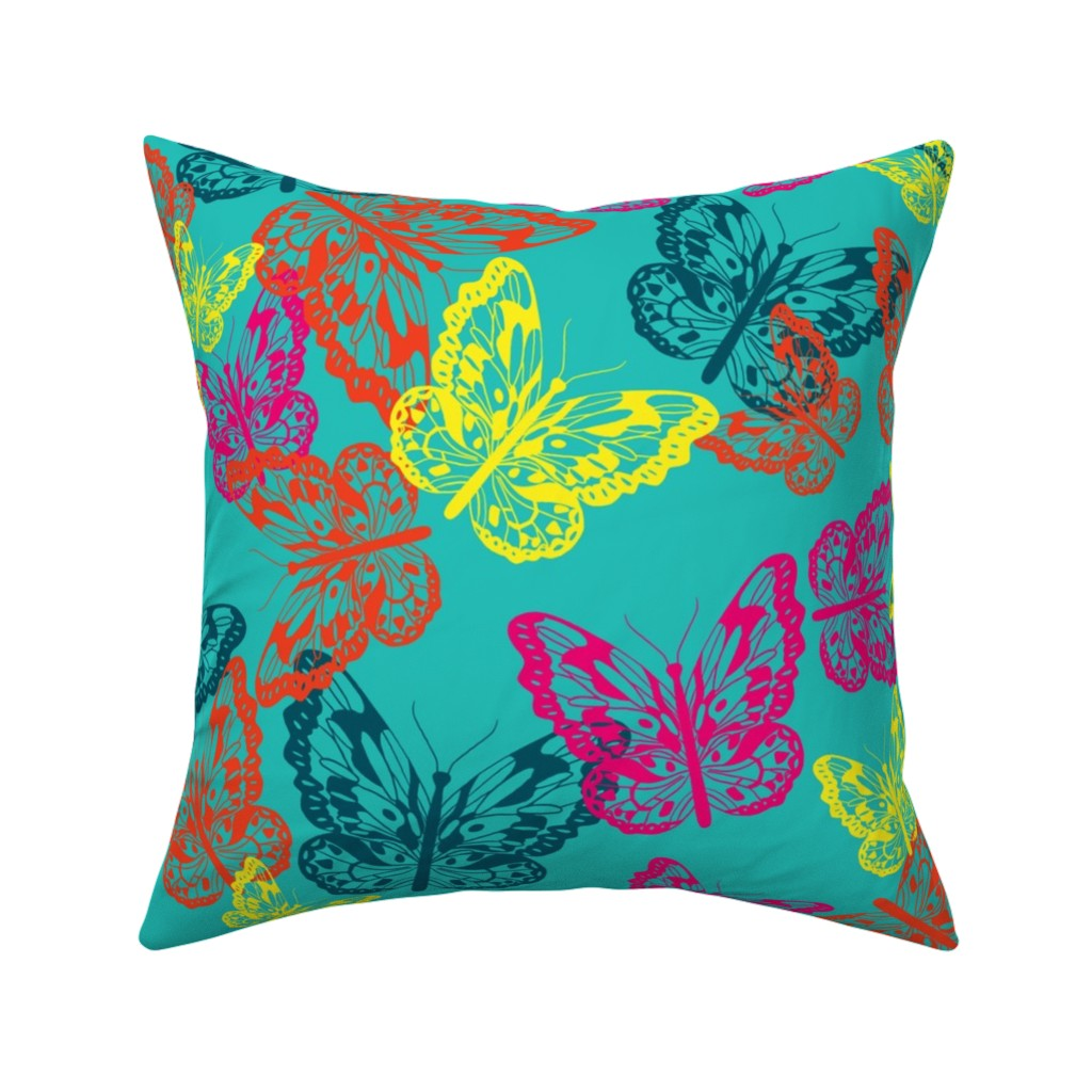 Catalan Throw Pillow featuring Butterfly Flurry in bright colors by jamiejaques