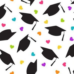 Tossed Graduation Caps with Rainbow Heart Confetti