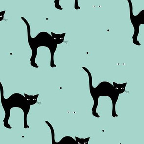 Cute retro style halloween black cats kitten design in fall winter colors mint green