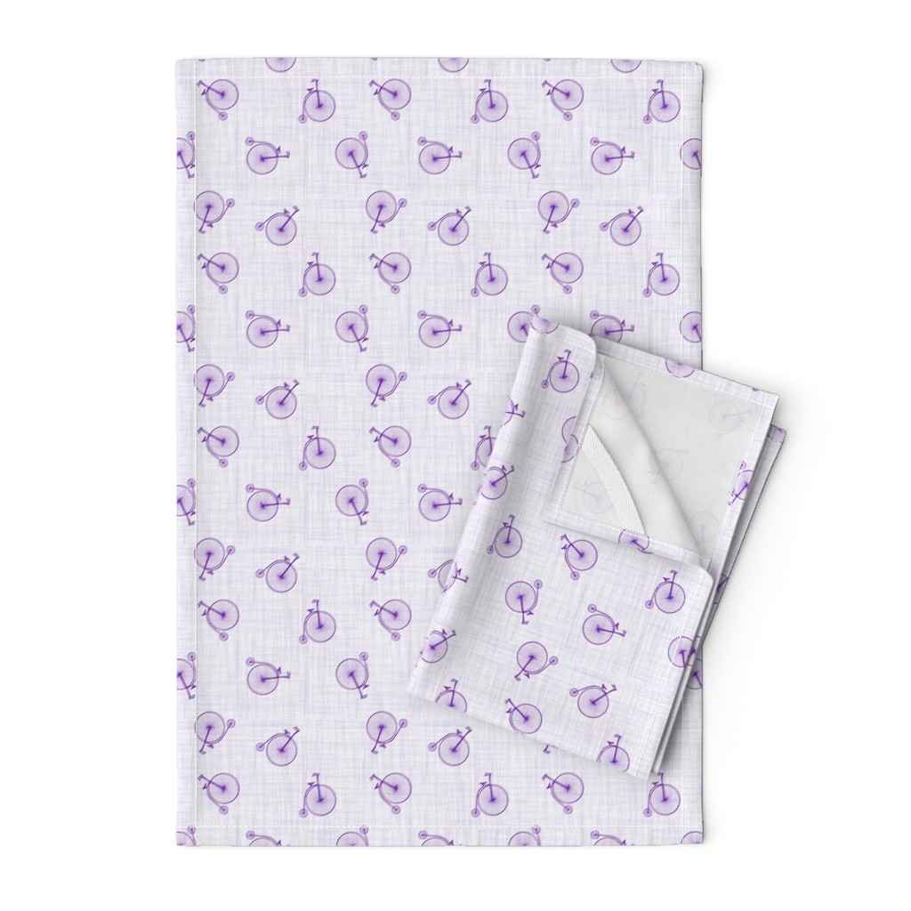 Orpington Tea Towels featuring high wheels violet by michaelakobyakov