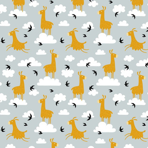 Llamas in the clouds with birds