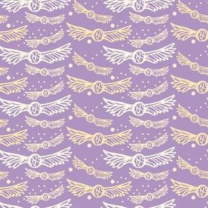 golden wings on lavender
