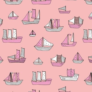 Fishing sailing boats and pirate ships on the shore and at sea pink summer