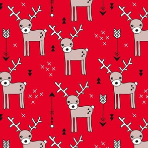 Adorable woodland reindeer and arrows christmas illustration kids pattern design in soft winter red