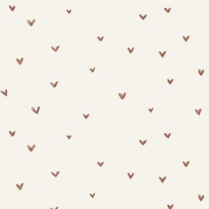 Rust red hearts on bone background