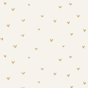 Mustard gold hearts on bone background