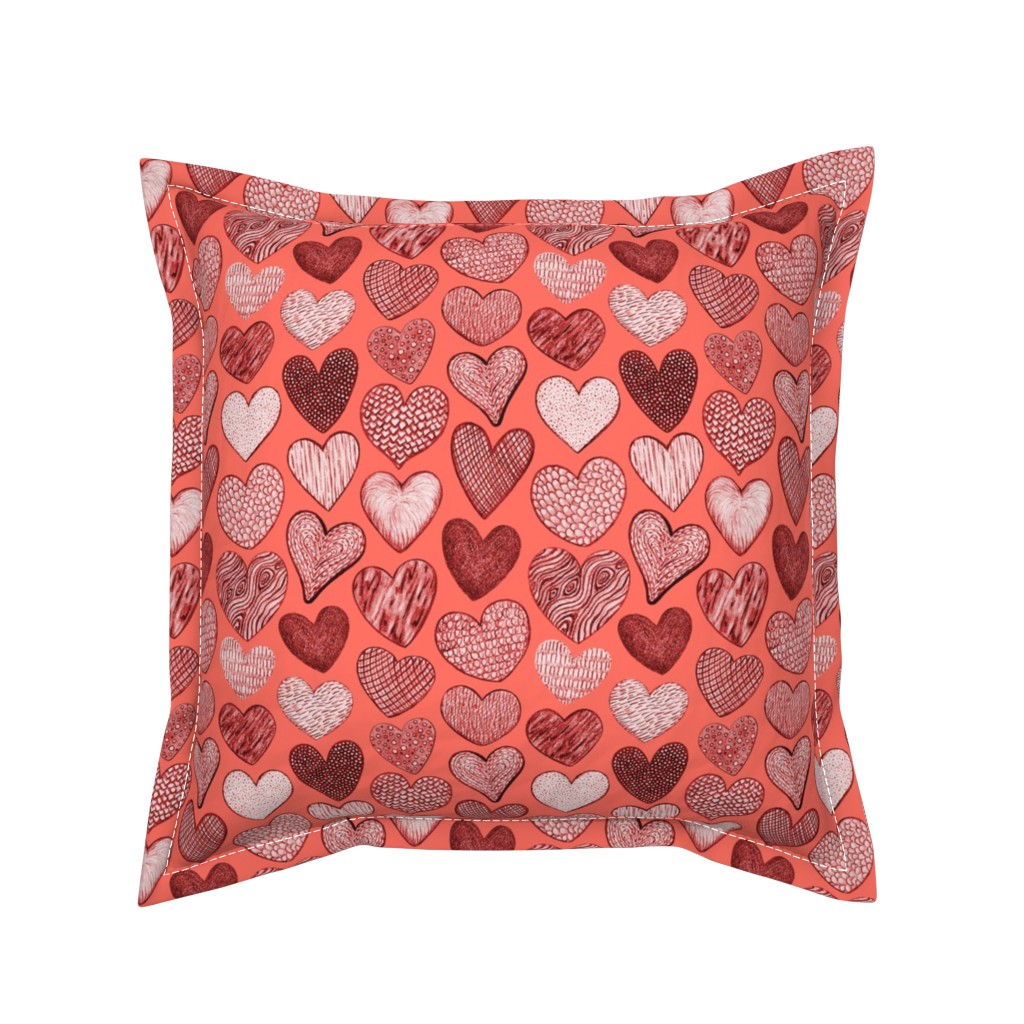 Serama Throw Pillow featuring Textured Hearts on Coral by dunnspun