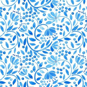 traditional blue watercolor flowers and berries