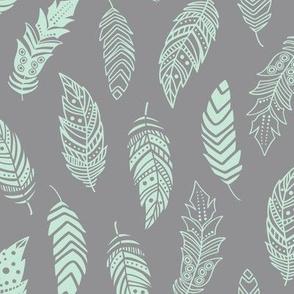 mint boho feathers on gray