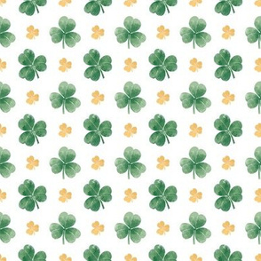 Three-leaf clovers in green and gold