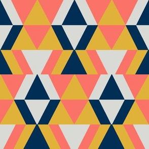 geometric shapes in coral and gold