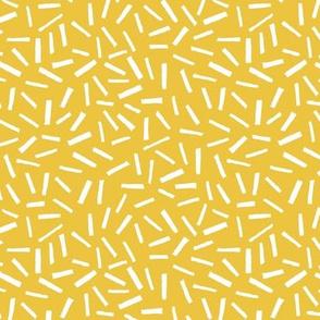 retro sprinkles white on mustard yellow