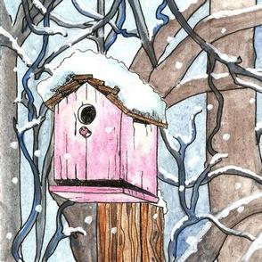 pink birdhouse in winter
