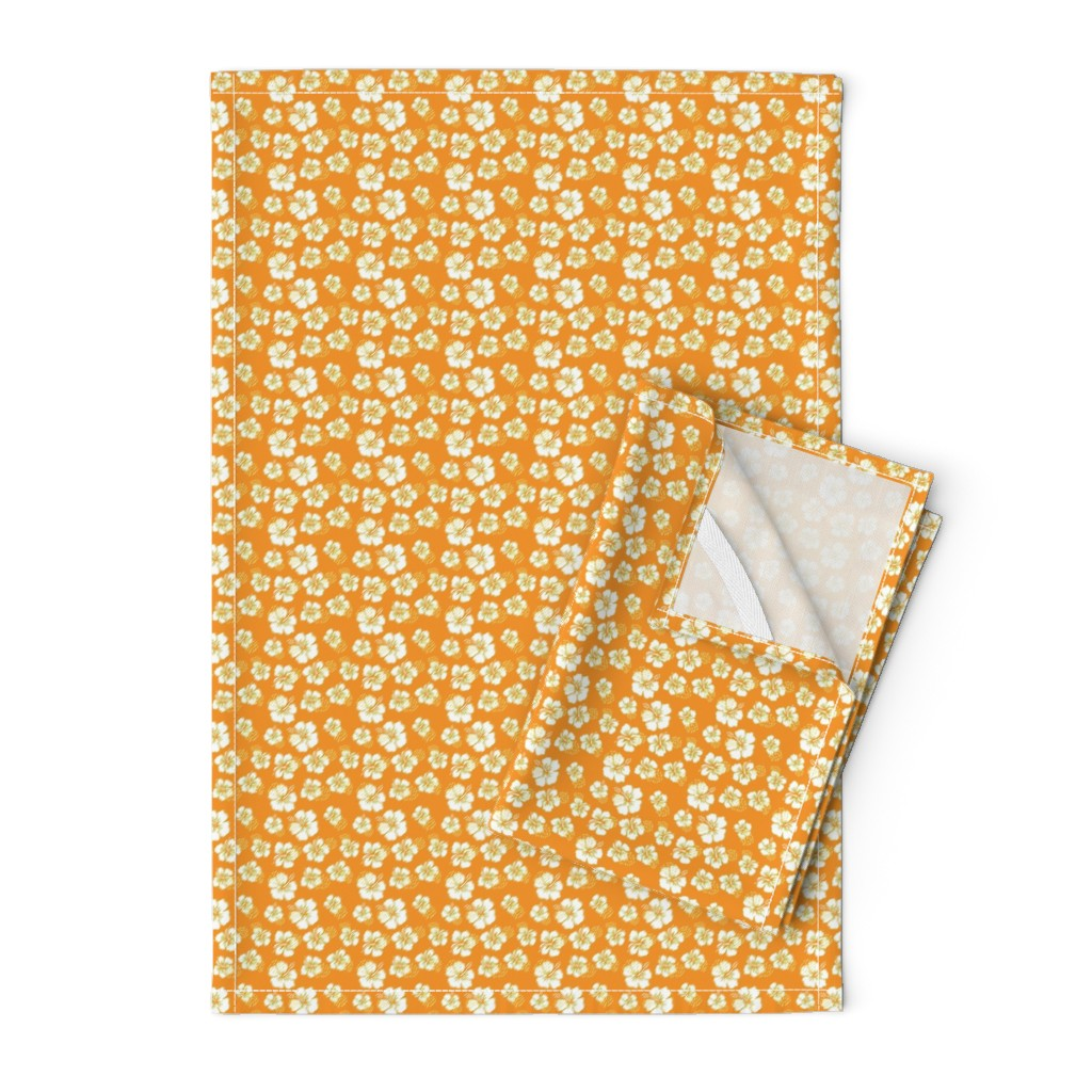 Orpington Tea Towels featuring Green hibiscus flowers on orange by kenza-graphics