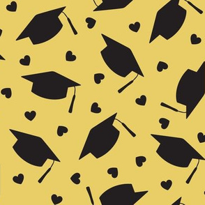 Tossed Graduation Caps with Black Hearts on Gold