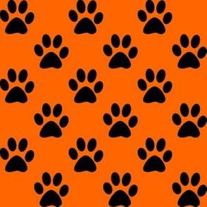 One Inch Black Paw Prints on Orange